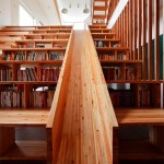 A Home Library Comes With A Wooden Slide