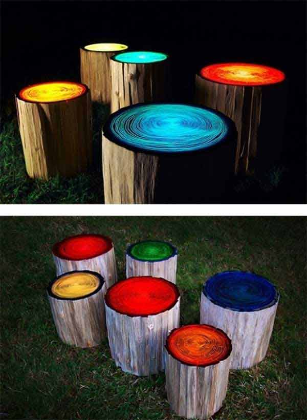 Log-stools-painted-with-glow-in-the-dark-paint