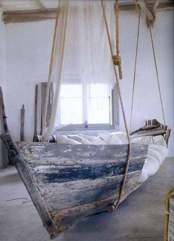 Old-boat-made-as-a-swing-bed