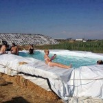 Cool Country Swimming Pool from Bales of Hay