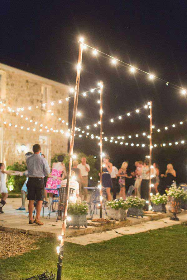 26 breathtaking yard and patio string lighting ideas will for How to hang string lights without trees
