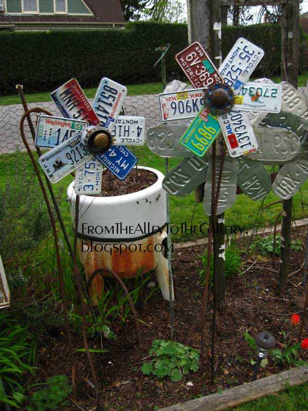 Garden Art Ideas watering can garden art ideas Easy Garden Projects Woohome 2