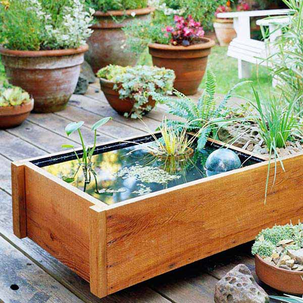 21 fascinating low budget diy mini ponds in a pot for Diy patio pond