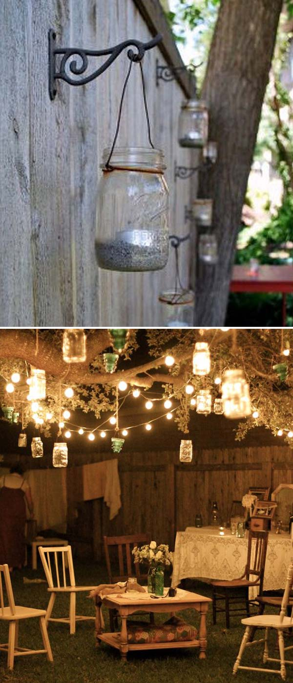 Outdoor hanging lanterns for patio - Adorn Your Backyard Tree With String Lights And Hanging Mason Jar Tea Lights