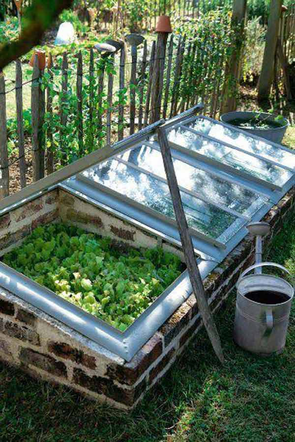 04-mini-greenhouse-made-from-recycled-bricks-and-windows