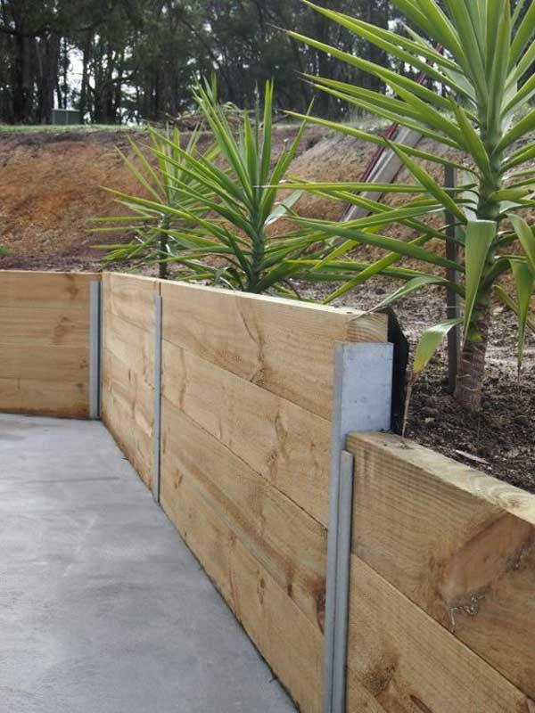 Home vegetable garden fence - 11 Build A Retaining Wall Using Quickcrete Bags Unopened And Stacked
