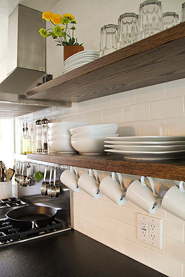 Set Two Floating Open Shelves By Using Long Steel Bars As Supports That Go  Through The Shelves And Into The Studs In The Wall.