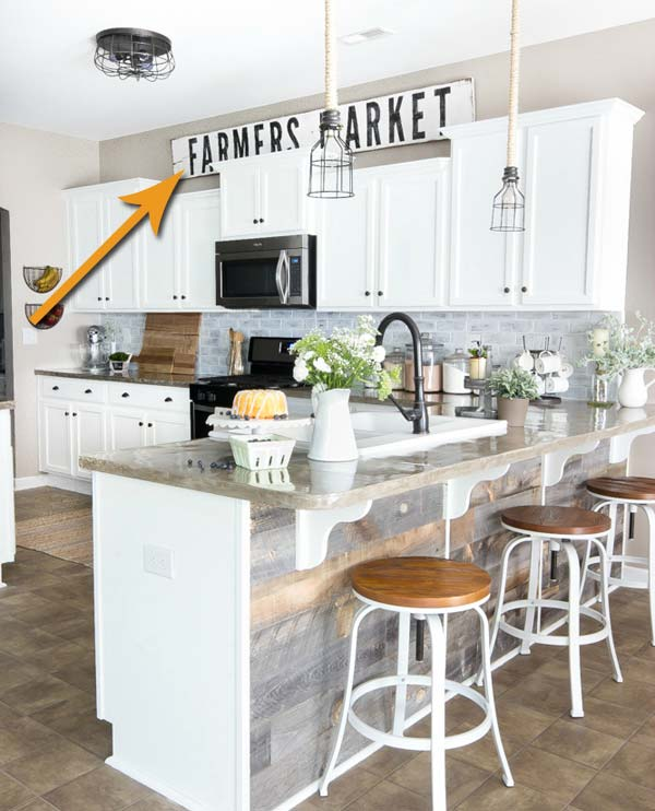 Make and place a giant farmhouse style sign above cabinets.