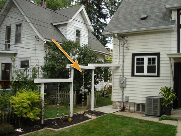 The best 20 diy ideas to create a decorative downspout landscape rain water passes over the gutter downspout and down the rain chain solutioingenieria Gallery