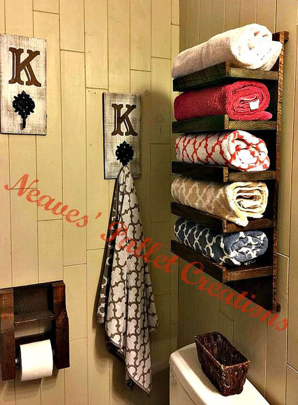 Re-purpose a piece of wooden pallet into towel rack