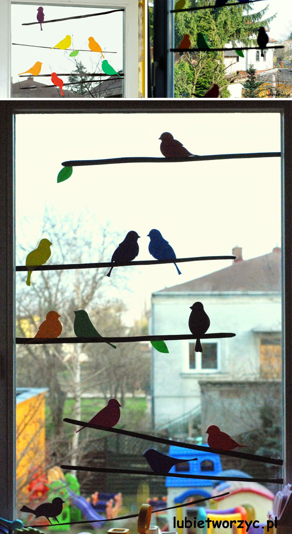 Colored sparrow and branches silhouettes on windows
