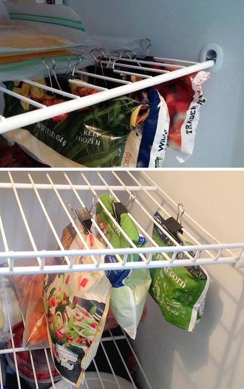 binder clips hanging from freezer shelves